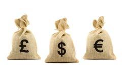 Drei braune Beutel mit Währungszeichen Stockbild