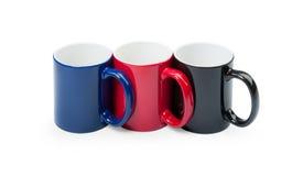 Drei bunte Cup in einer Reihe Lizenzfreies Stockbild
