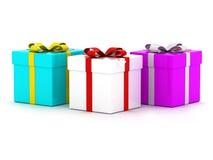 Drei bunte Geschenk-Kästen Stockfotos