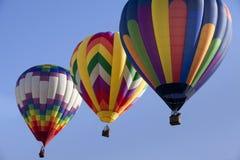 Drei bunte Heißluft-Ballone Lizenzfreie Stockfotografie