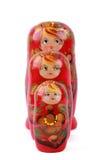 Drei bunte russische Puppen über Weiß Stockfotos