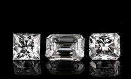 Drei Diamanten auf dem schwarzen Hintergrund Lizenzfreies Stockfoto