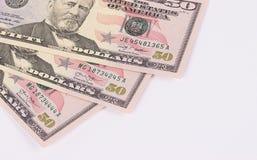 Drei 50-Dollar-Banknoten lokalisiert auf weißem Hintergrund Stockbild