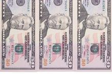 Drei 50-Dollar-Banknoten lokalisiert auf weißem Hintergrund Lizenzfreies Stockbild