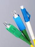 Drei einzelne Faseroptikverbindungsstücke Stockfoto