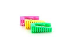 Drei farbige Bleistiftspitzer Stockfotografie