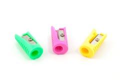 Drei farbige Bleistiftspitzer Lizenzfreie Stockfotos