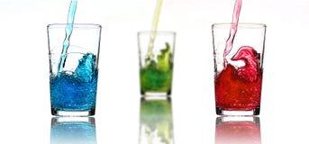 Drei farbige Gläser Stockfotos