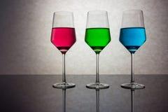 Drei farbige Gläser Wasser RGB Lizenzfreie Stockbilder