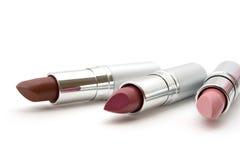 Drei farbiger Lippenstift Stockfotografie