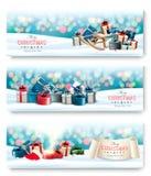 Drei Feiertags-Weihnachtsfahnen mit Geschenken und magischem Kasten vektor abbildung