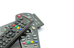 Drei Fernsehfernbedienungen über weißem Hintergrund Stockbilder