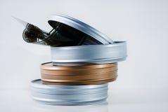 Drei Filmzinn mit Filmbandspule Stockbild