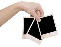 Drei Fotofelder in einer Hand Stockfotografie