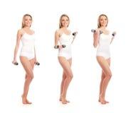 Drei Frauen in der weißen Kleidung, die Dumbbells anhält Stockfoto