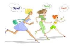 Drei Frauen, die auf Verkauf laufen Lizenzfreie Stockbilder