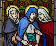 Drei Frauen unter dem Kreuz Stockbild