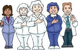Drei freundliche Gesundheitspflegearbeitskräfte auf weißem Hintergrund Lizenzfreie Stockfotos