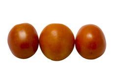 Drei frische Tomaten lokalisiert auf weißem Hintergrund Stockfoto
