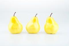 Drei gelbe Birnen Lizenzfreie Stockfotos