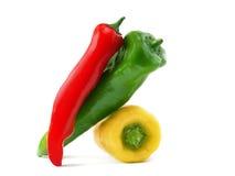 Drei gelbe rote grüne Paprikas Stockbild
