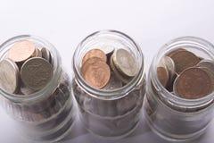 Drei Geld-Gläser Stockfotos
