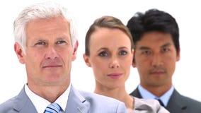 Drei Geschäftsleute in einer Linie Stockbild