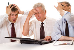 Drei Geschäftsmänner, die zusammenarbeiten Stockfotografie