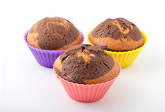 Drei geschmackvolle frisch gebackene Muffins Stockfotografie