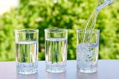 Drei Gläser Wasser Stockfoto