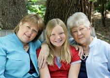 Drei glückliche Damen Stockfotos