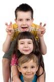 Drei glückliche Kinder, die Spaß haben Stockfoto