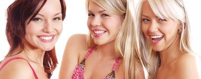 Drei glückliche Mädchen getrennt auf einem weißen Hintergrund Lizenzfreie Stockbilder