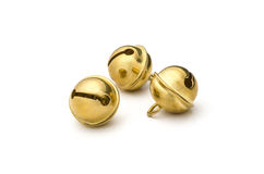 Drei goldene Pferdeschlittenglocken Lizenzfreie Stockfotos