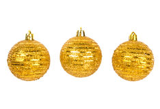 Drei goldene Weihnachtskugeln auf Weiß Lizenzfreie Stockbilder