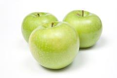 Drei grüne Äpfel Stockbild