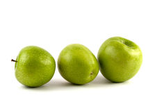 Drei grüne Äpfel Lizenzfreie Stockfotos