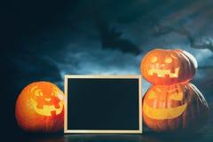 Drei ` Halloweens Jack O Laternenkürbise Stockbilder
