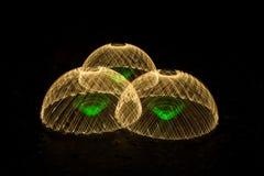 Drei Hauben gemacht vom Licht Lizenzfreies Stockbild