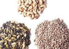 Drei Haufen von Samen und von Nüssen Stockbilder