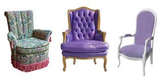 Drei herrliche Weinleselehnsessel lokalisiert auf weißem Hintergrund Stühle mit gepolstert im Gewebe, im velor und in ledernem, i stockbilder
