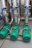 Drei industrielle Pumpen Stockbild