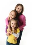 Drei junge Schwestern, die Spaß haben Stockfotos