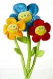 Drei künstliche Blumen Stockbilder
