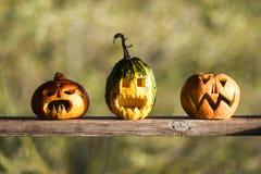 Drei Kürbise für Halloween-Partei Lizenzfreie Stockbilder