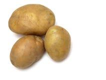 Drei Kartoffeln auf Weiß Stockbild