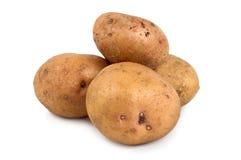 Drei Kartoffeln getrennt auf einem Weiß Lizenzfreies Stockbild