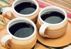 Drei keramische Tasse Kaffees Lizenzfreie Stockbilder