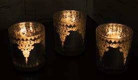 Drei Kerzen in einem Glas Lizenzfreie Stockfotos