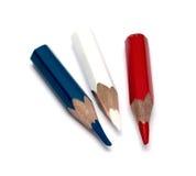 Drei kleine benutzte farbige Bleistifte Stockfotografie